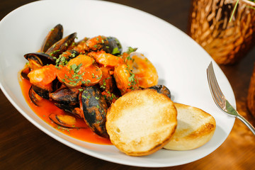 Baked shellfish mussels with potatoes and bread
