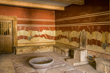 Palace of Knossos, throne room. Walls decorated with ancient frescoes. Royal throne in front of a mysterious bowl.