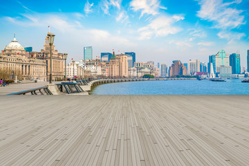 Blue sky, empty marble floor and skyline of Shanghai urban architecture.