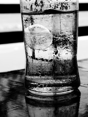black and white Ice in water glass