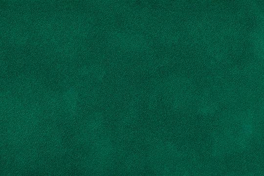 Dark green matt suede fabric closeup. Velvet texture.