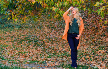 Woman walk sunset light. Cozy casual outfits for late fall. Comfortable outfit. Girl adorable blonde posing in warm and cozy outfit autumn nature background defocused. Cozy outfit ideas for weekend