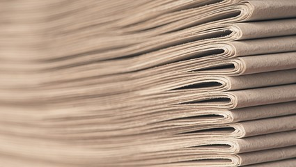 Stack of old newspapers - Soft focus with copy space.
