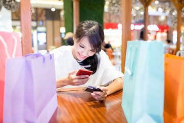 woman use phone and card
