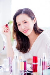 Woman using mascara brush