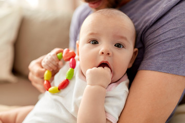 family, parenthood and people concept - close up of father with little baby girl at home