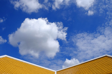 yellow roof with blue sky