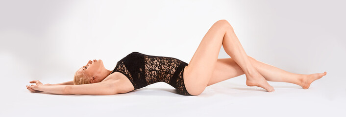 beautyful young blonde woman lies on background