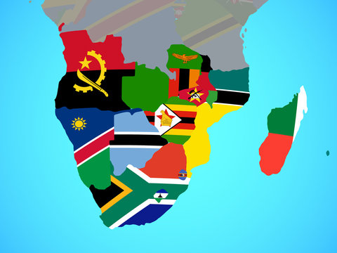 Southern Africa with national flags on blue political globe.
