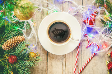 cup of coffee on a christmas background. Christmas morning. Selective focus.