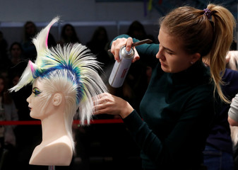 """A mannequin has its hair done backstage during the Beauty Festival """"Windrose HAIR-2018"""" in Minsk"""