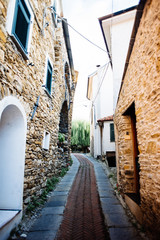 ancient village of the Ligurian hinterland, narrow streets and colored walls
