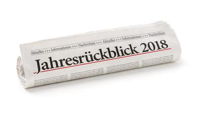 Zeitungsrolle mit der Überschrift Jahresrückblick 2018