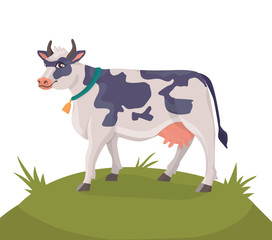 cheerful cow on a green meadow