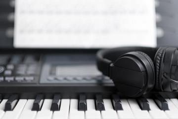 Electronic musical keyboard piano with headphone for music background
