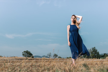 Elegant woman standing in field