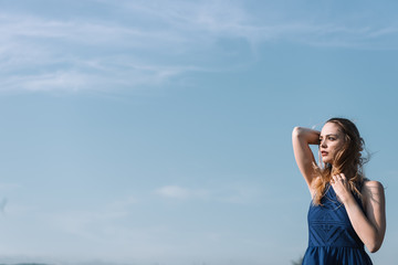 Elegant woman against blue sky