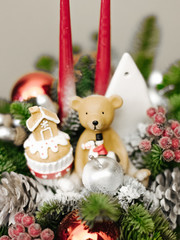 Christmas decoration candlestick with toy teddy bear and gingerbread house