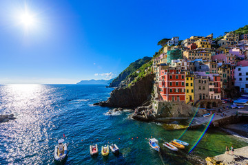 Wall Mural - Riomaggiore - Village of Cinque Terre National Park at Coast of Italy. Beautiful colors at sunset. Province of La Spezia, Liguria, in the north of Italy - Travel destination and attractions in Europe.