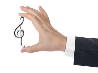Fototapete - Hand holding a treble clef