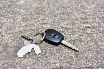 Car key drop on the road background.Car key lost on the road