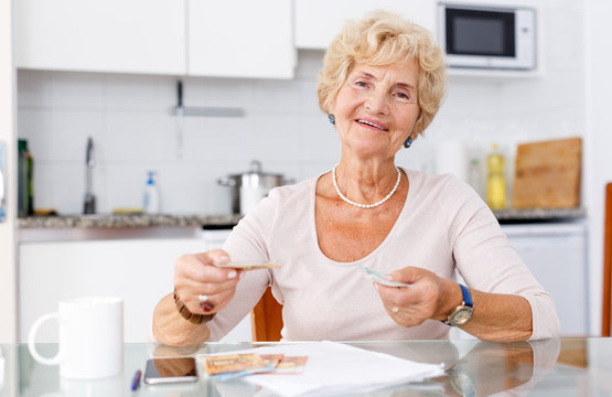 Mature woman counting her cash