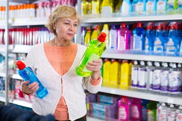 Blonde female choosing household chemical goods