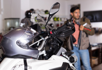 Photo of motobike with equipment in the sport store.