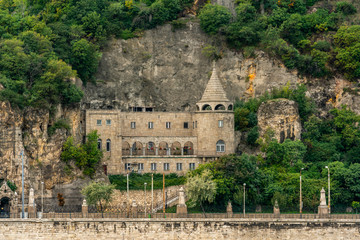 Front view of the beautiful old stone church at Gellért Hill Cave i Budapest Hungary.