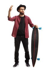 Male hipster holding a longboard and gesturing peace with fingers