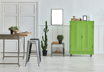 Modern white room dining table and char style with green cabinet and frame decoration.