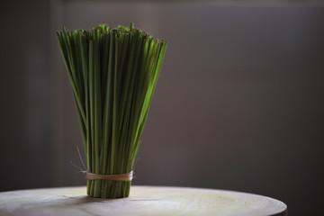 Fresh lemongrass (citronella) on wooden