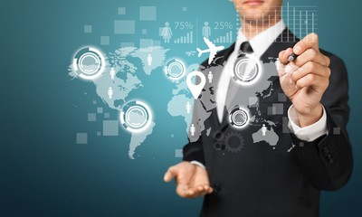 Businessman and  business symbols on  background