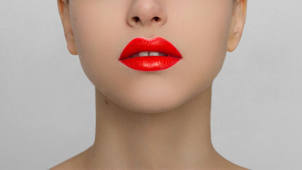Foto op Canvas Fashion Lips The macro photo of the closed female mouth. Chubby lips with red lipstick show a fashionable make-up and increase in lips. Cosmetology, Spa, cosmetics