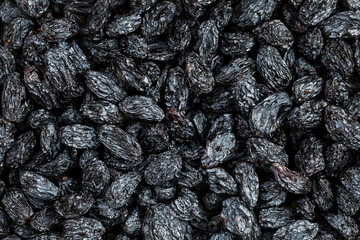 Black Raisin texture, popular dried fruit. Dried grapes.