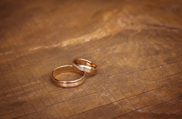 Wedding rings on table, top view