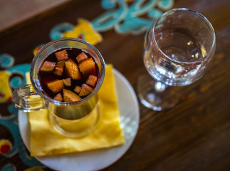 Christmas hot mulled wine with different fruits and spices,  selective focus