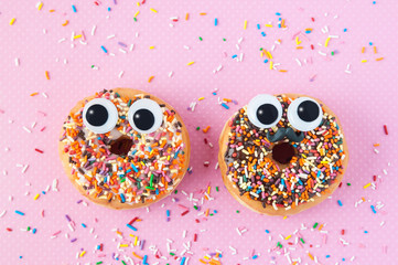 funny donuts with eyes Fotobehang