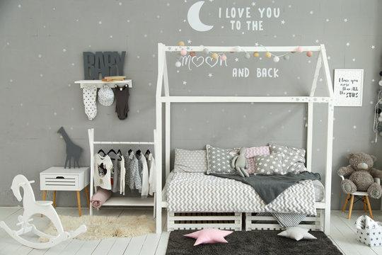 modern children's room in gray tones
