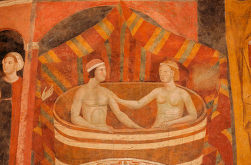 In de dag Rood traf. Woman and man bathing on 14th century fresco inside historical Palazzo del Podesta