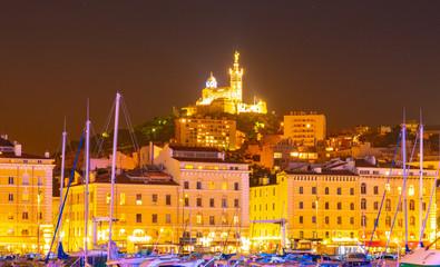 Marseille, France at night. The famous european harbour view on the Notre Dame de la Garde