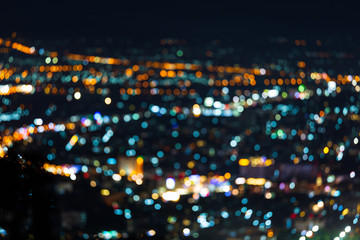 Colorful light Abstract circular bokeh of the city at night background. Wall mural