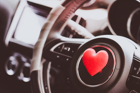 Steering wheel with heart red object.Love car concept idea.interior console car.