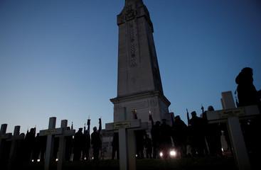 War veterans attend a remembrance ceremony at the monument of the Notre Dame de Lorette War Cemetery near Arras