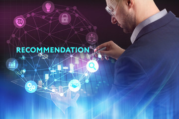 The concept of business, technology, the Internet and the network. A young entrepreneur working on a virtual screen of the future and sees the inscription: Recommendation