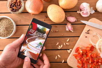 Using digital cookbook app in smartphone for cooking
