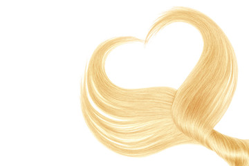 Blond hair in shape of heart, isolated on white background