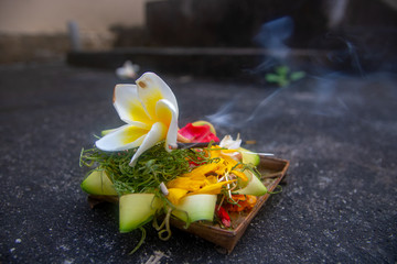 flowers offerings and temples bali indonesia