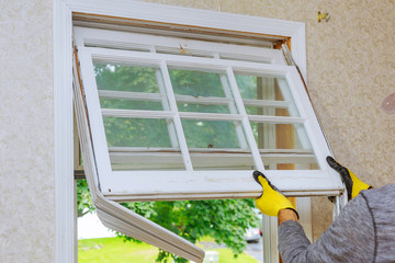 Fototapeta Master removes old home repairs, replacement windows obraz