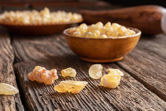 Frankincense resin crystals on a wooden background